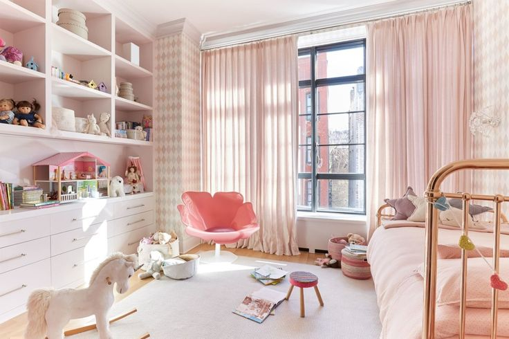 Sophisticated harlequin-patterned Cole & Son wallpaper keeps the rosy child's bedroom from being too babyish | archdigest.com
