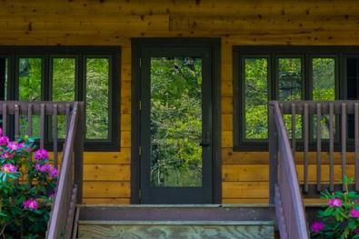 Log home with black trim front door front back door for Windows for log cabins
