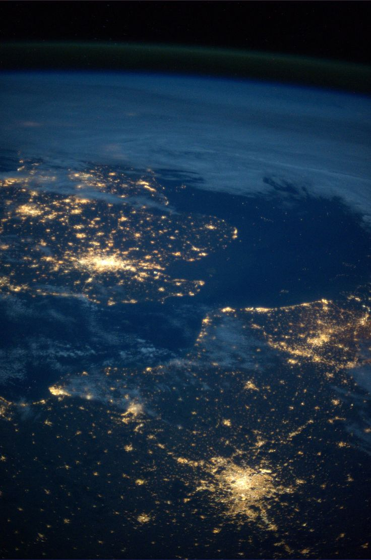 Photograph taken from onboard the International Space Station showing a nighttime Paris and London.   Aaron: Wow! Its amazing to see what we look like from above!