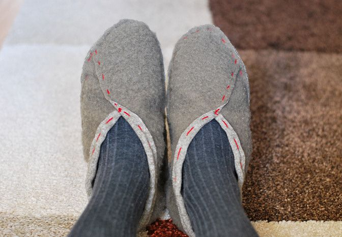 Easy To Sew Slippers - the design's a good starting point, but I'd want to tidy up the look quite a bit.  From http://ragstocouture.com/easy-to-make-slippers-diy-tutorial/