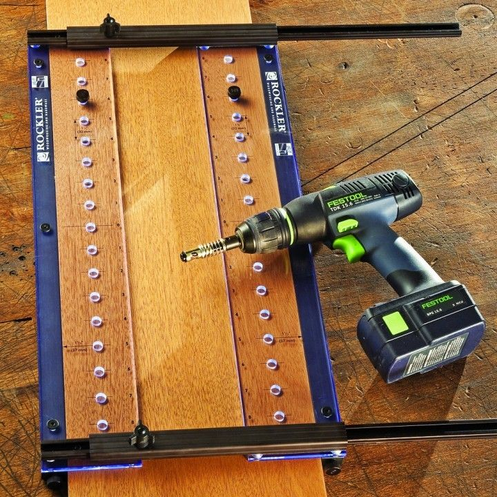 http://www.rockler.com/pro-shelf-drilling-jig-with-1-4-shelf-drilling-bit-and-case