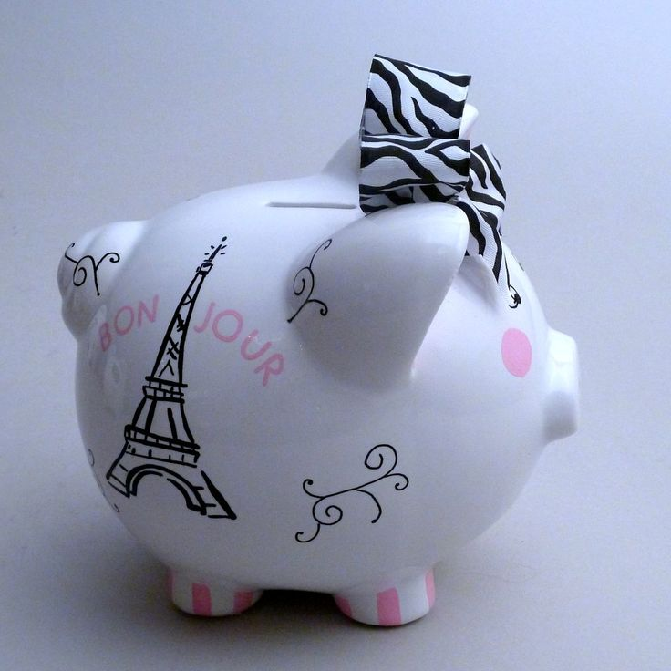 Large Zebra Piggy Bank with the Eiffel Tower on one side and zebra stripes and a name on the other side.