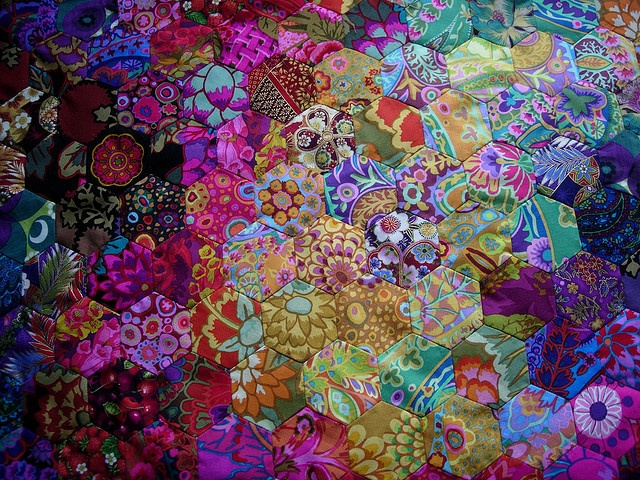 Beautiful colorful fabrics. I want to make a hexagon quilt someday just like this one!!!