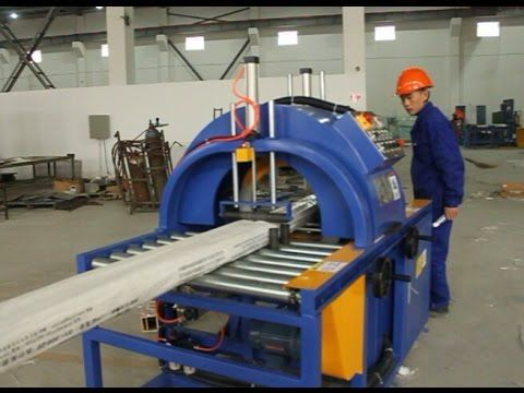 Horizontal orbital stretch wrapper and wrapping machine for wooden
