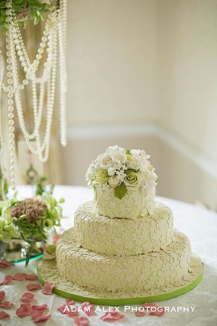Three-tier green lace cake by Elizabeth's Cake Emporium. Made to match an Oscar de la Renta wedding dress.