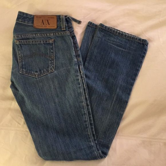 Armani exchange boot cut jeans in light blue Moderately worn boot cut jeans in good condition in petite 0 regular. One belt tab is torn as shown. A/X Armani Exchange Jeans Boot Cut
