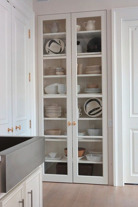 floor to ceiling shevles/closet. enclosed. lynda reeves kitchen