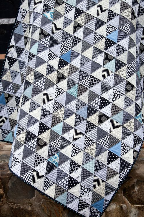 Love, love, love this black and white quilt. I would have never thought about adding the blue. May make this but with squares because they appeal to me more than triangles.