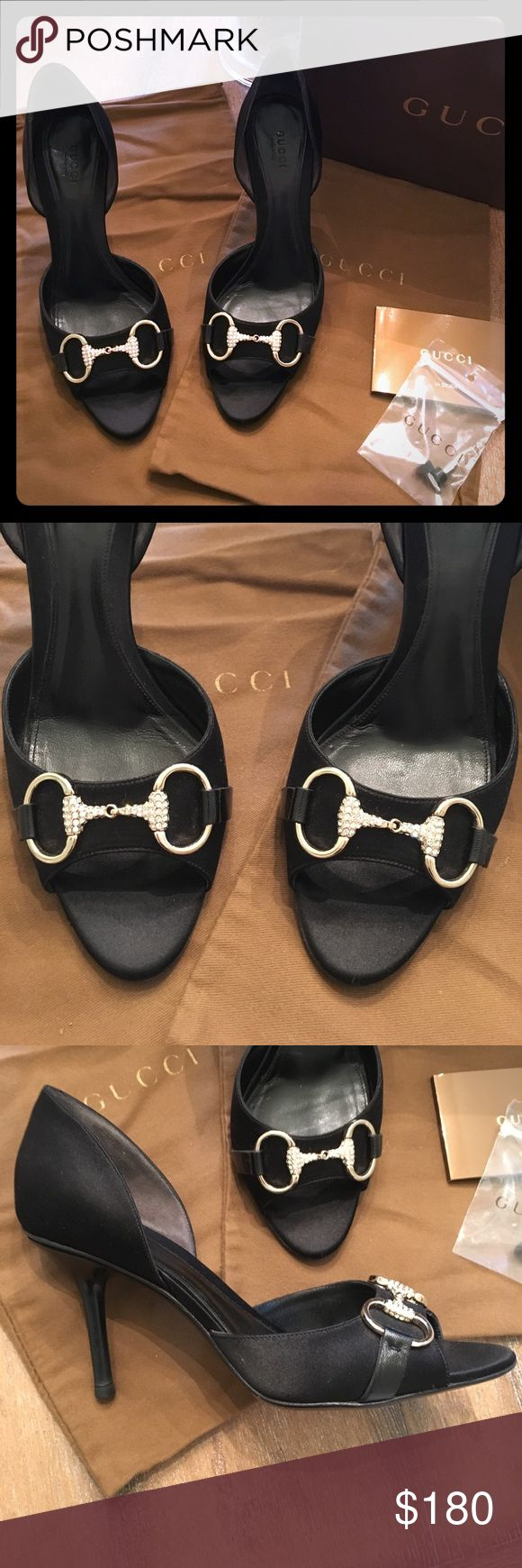 Gucci black satin heel w/ signature crystal buckle Gorgeous black satin Guccis. Worn a few times. In great visible condition. Heels have damage as shown in pic. Box, protective pouches and replacement heel stoppers included. Gucci Shoes Heels