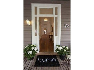 Love this entrance, colours of the house and mat.