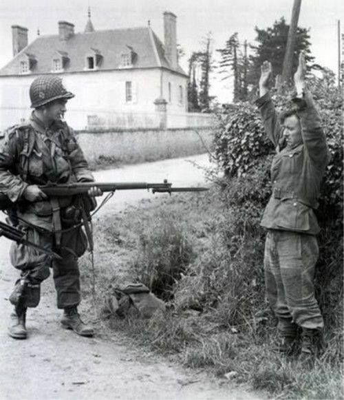 German soldier surrendering to a U.S Paratrooper Normandy 1944.