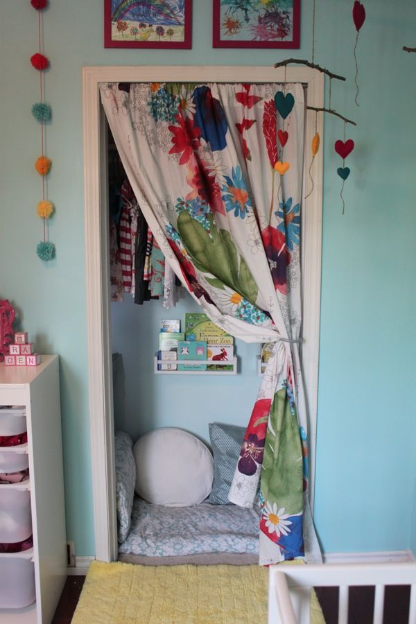 "Transform the space under Q's built-in desk into a reading nook. Staple fabric along ""ceiling"" and sides and add comfy pillows. Add a shelf or basket for books. Use her DREAM hooks for her dress-up clothes."
