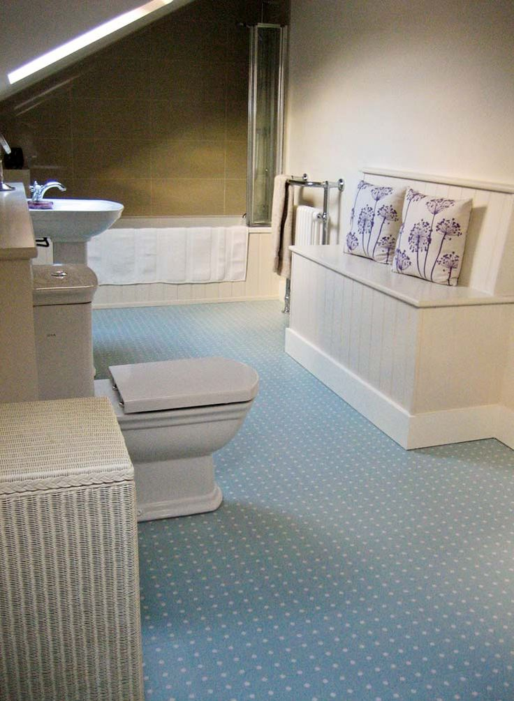 Joanna's new bathroom featuring our timeless Spot Blue floor design by Cath Kidston
