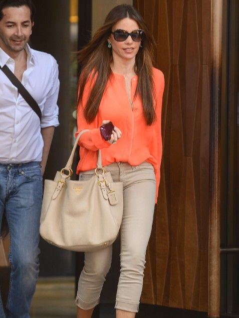 Making Pantone's color of the year her own, Sofia Vergara complements an orange blouse with sexy nude hues.