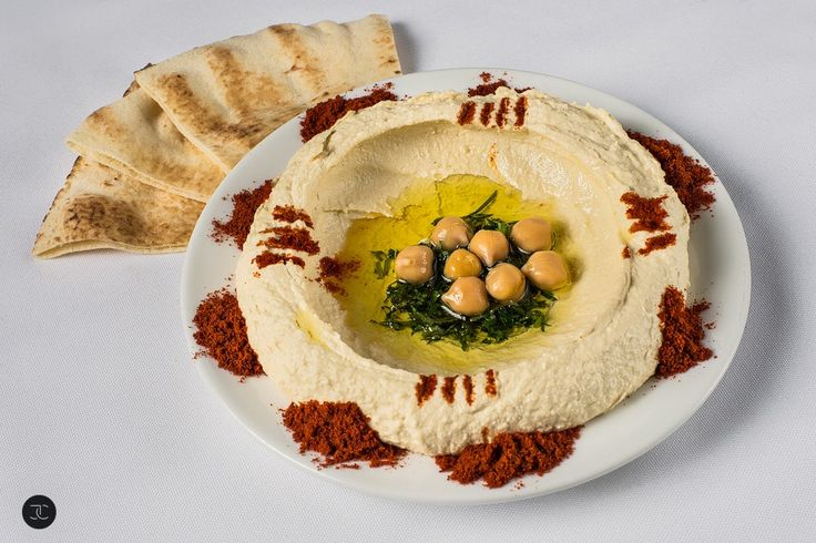 ~ Hummus ~  A chick pea dip served with olive oil and pita bread.