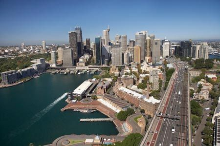 Circular Quay Ferry Terminal, CBD, Bradfield Highway (approach to Sydney Harbour Bridge), and The Rocks, Sydney, New South Wales, Australia - aerial