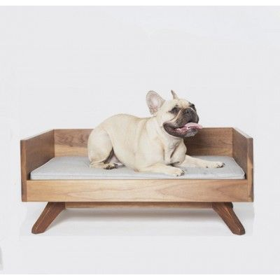 <p>Made-to-order by local craftsman out of solid walnut wood in Toronto, this luxury dog (or cat!) bed makes us want to curl up and take a nap. It's way more stylish than any other pet furniture, and the elevated bed uses only organic cotton filled with natural soy foam. The cushion is removable and easy to wash -  which is handy when your furry friend tracks in dirt or water. Bed weighs about 35 pounds. Made in Toronto, Ontario. Chose from 6 attractive mid-century modern prints.</p> <...
