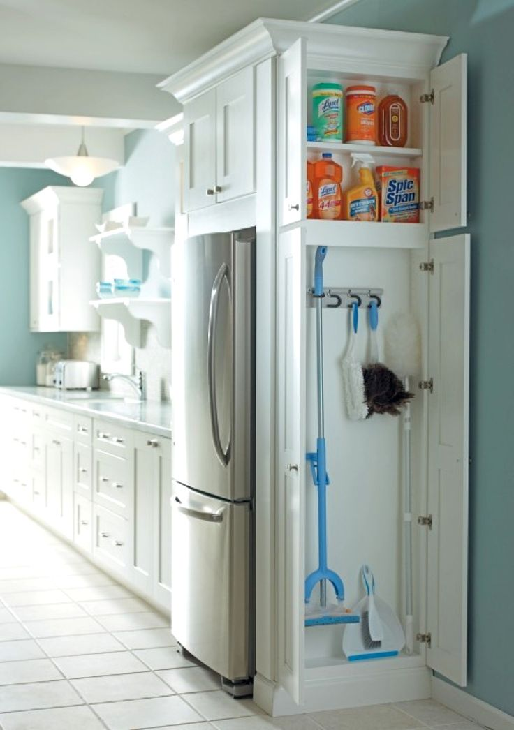 Nice small cabinet for broom and cleaning supplies. Great way to add the needed storage with a small and accessible footprint.