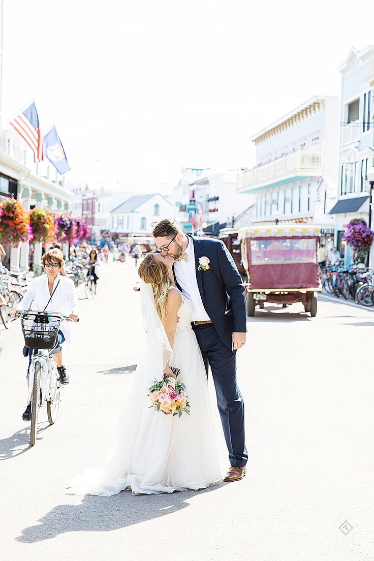 Couple walking down main street on mackinac island | Rayan Anastor Photography | Mackinac Island Wedding Photographer