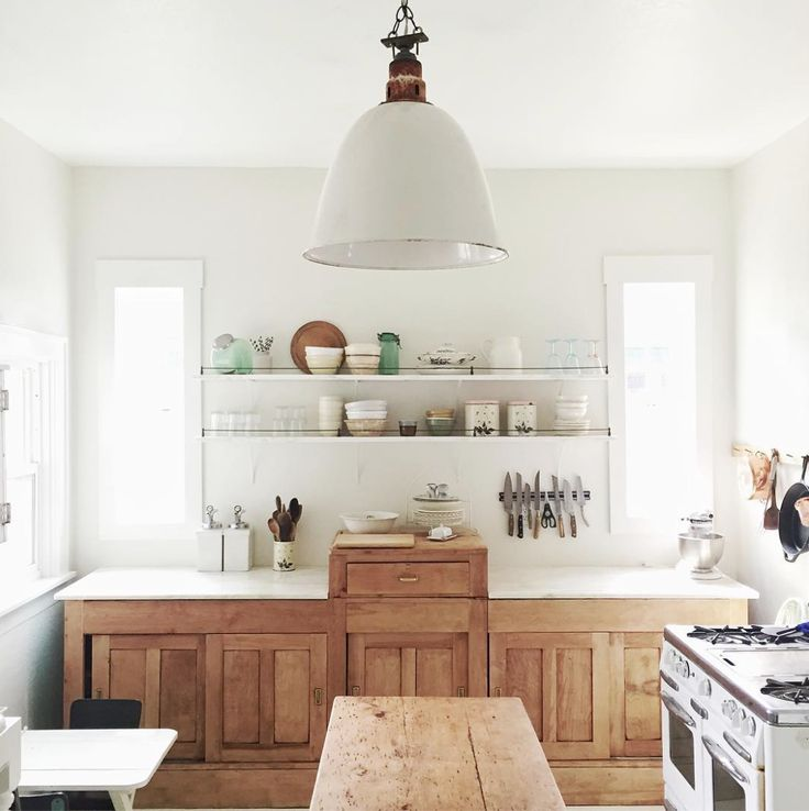 Love this kitchen work space with the raised butcher block