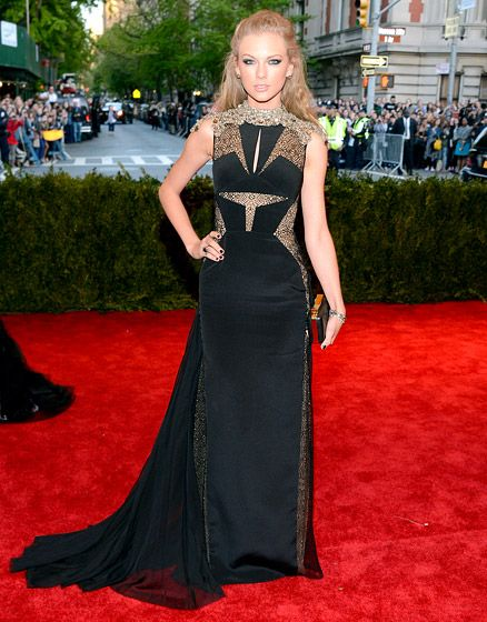 Taylor Swift in black and gold J. Mendel at the 2013 Met Gala