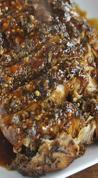 This pork cooks on low in the slow cooker for about 6 hours and when it comes out it is so nice and tender and just about falls apart on you.