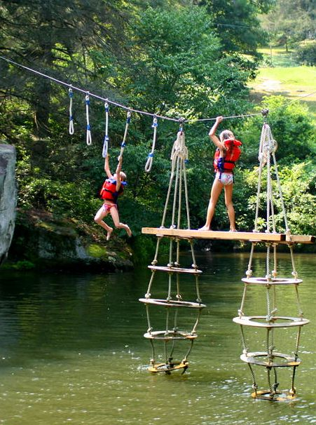 """One popular summer game for kids at camp is """"the toy"""" over the Rockbrook Camp lake."""