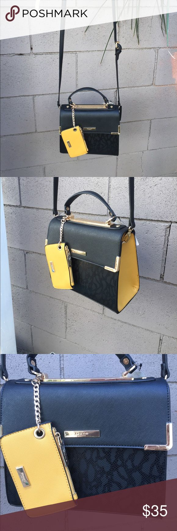 Black/yellow shoulder/or use handle w/coin purse Black/yellow hand bag with shoulder strap.  Has removable yellow coin purse. Dune of London Bags Shoulder Bags