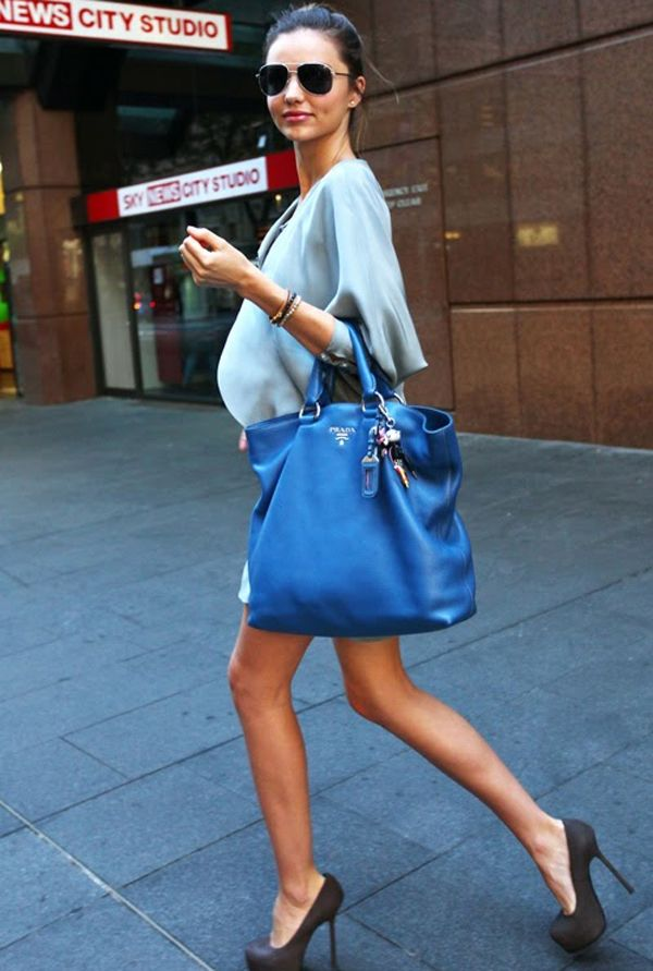 Baby blue batwing dress, electric blue Prada tote, and grey suede ...