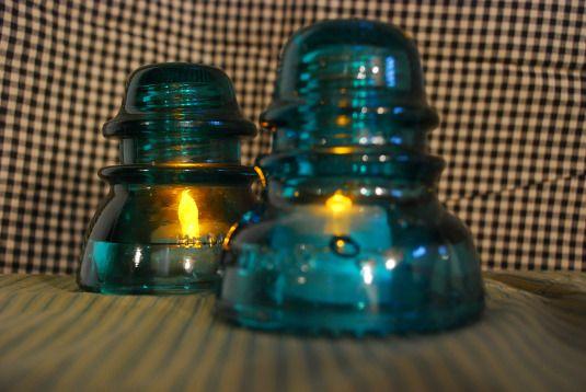Glass insulators as nightlights with Dollar Tree battery flicker lights under them