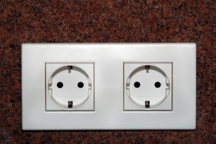 Childproofing a nursery includes the important step of covering all electrical outlets.