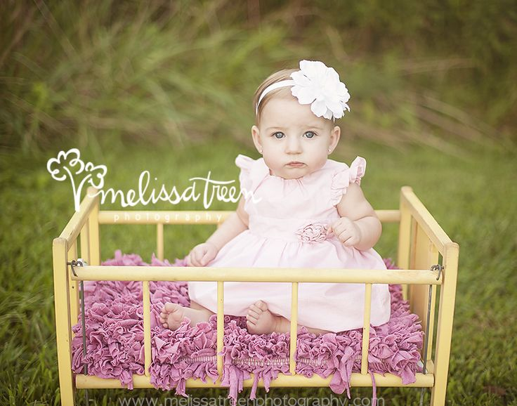 Beautiful 6 month old baby girl in yellow cradle and pink dress outdoor in nature natural light photography stokesdale kernersville browns summit oak ridge