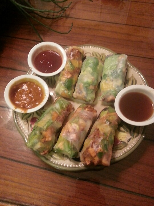 Asian spring rolls with mixed greens, mint, cilantro, shredded carrots ...
