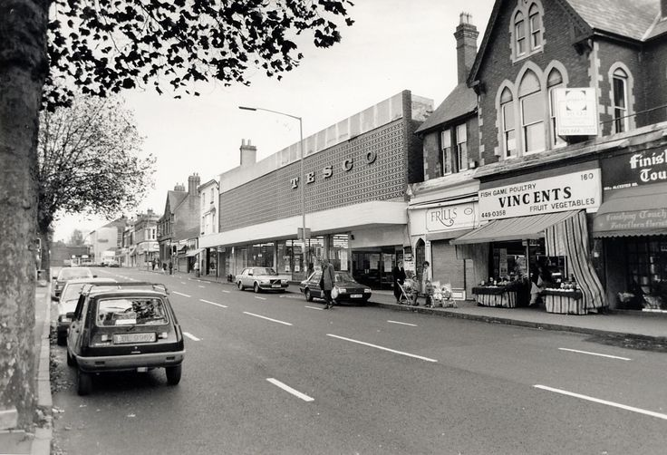 Tesco's 1960's style architecture in Moseley village swamps the other buildings.