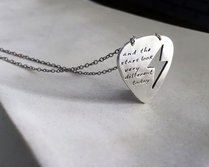 "The custom Guitar Pick with Lightening Bolt cut out is unique and personalized to say whatever you want. It is shown with a David Bowie tribute ""and the stars look very different today"". I can make th"