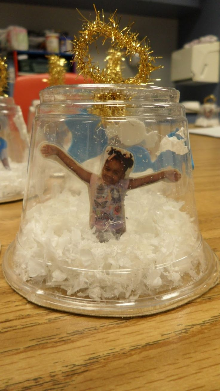 Cute Christmas ornament craft! This would be awesome for a writing activity (the day I got trapped in a snowglobe).
