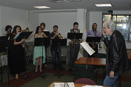 """MCCC Music Professor James Kelly directs Mercer jazz students during a performance at the """"Explore Mercer!"""" open house April 9, 2014."""