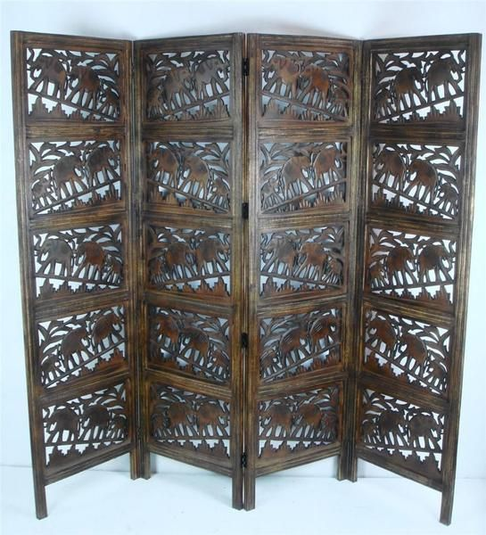 This beautiful hand made four panel screen can be used as a room divider or as a stand alone decorative piece. The screen would look great in a living room, con