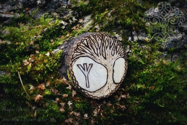 An ash amulet with Yggdrasil, and rune Algiz.