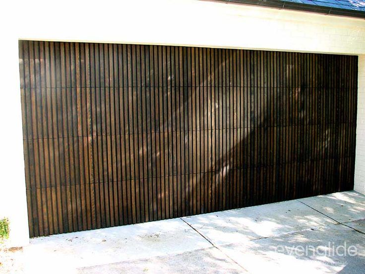 Timber sectional door consisting of plywood timber and Western Red Cedar battens attached to the face.