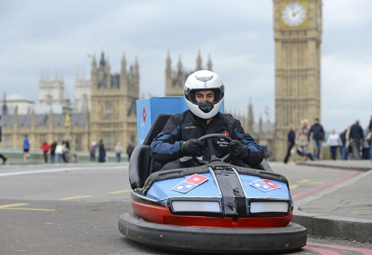 Motorists were stunned when they spotted a delivery driver handing out doughnuts - in a fairground-style dodgem. The one-of-a-kind delivery driver whizzed around London giving the treats to unsuspecting people. The Domino's Pizza delivery driver covered a staggering 18.6 miles in the dodgem - the equivalent of 365,992 new Domino's Doughnuts lined up next to each other.