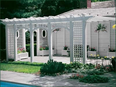 Trellis Framed Pergola - Create an inviting outdoor room with the imaginative combination of an airy pergola attached to an arbor with vertical/horizontal lattice panels.