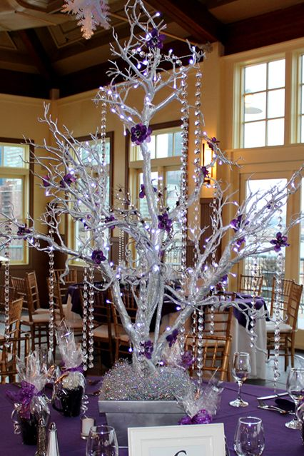 Silver Tree Centerpiece Wrapped with LED Lights  http://www.shopwildthings.com/naturalwhitetreebranchcenterpiece.html