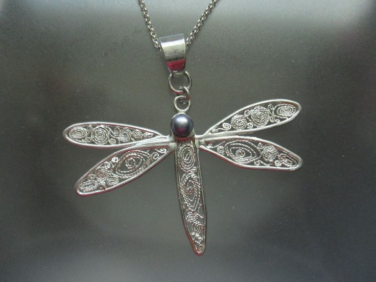 """""""Dragonfly Pendant"""" Sterling silver handcrafted filigree with a Cultured Pearl. Artist:  Marie Wood."""