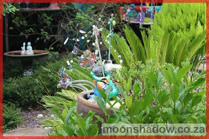Cherubs, Buddhas and sparkly décor all add to the garden's magick.  #Swellendam #Moonshadow