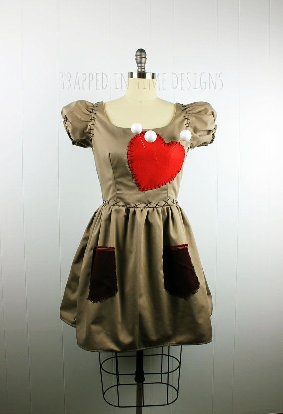 Womens Voodoo Doll Dress--perfect for Halloween and costume parties!  My interpretation of a New Orleans specialty--the voodoo doll! This is my second version of a Voodoo Doll, and I have to admit--its my favorite!  This Voodoo Doll dress is made just for you using cotton twill, fully lined in cotton-poly blend. Featuring short, puff sleeves, a fitted bodice, full skirt and a back zipper. Felt heart sewn onto bodice and two pockets sewn onto skirt (please note pocket colors will vary--if…
