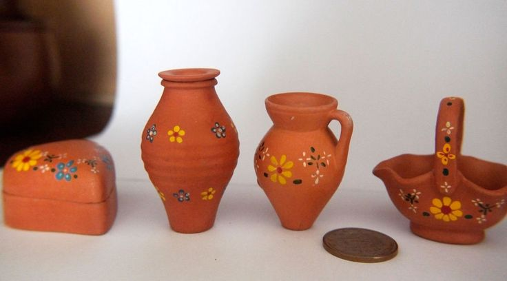 Vintage miniatures in red clay of traditional Portuguese objects.