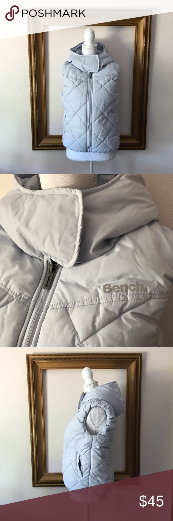 Bench light blue insulated puffy hooded vest, L In good used condition. Small dirt stain above logo on back right. 20 inches armpit to armpit. 24 inches shoulder to bottom of vest. Bench Jackets & Coats Vests