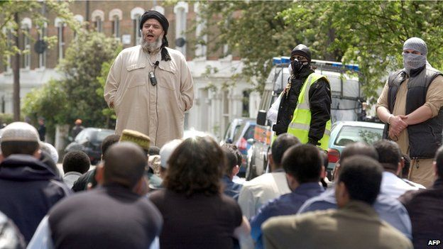 Abu Hamza outside Finbury Park mosque - Abu Hamza al-Masri has been found guilty of supporting terrorism by a court in New York and sentenced to life in prison. But who is the man who became the most prominent radical cleric in the United Kingdom?