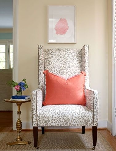 Love this cheetah print cream and silver high backed chair accented with coral pillow